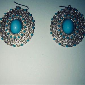 A pair of blue earrings